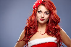 Christmas Santa hat redhair woman portrait . Stock Image
