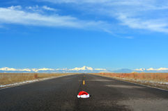 Christmas Santa Hat In Road Travel Concept Royalty Free Stock Images