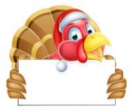Christmas Santa Hat Turkey Holding a Sign Stock Photos