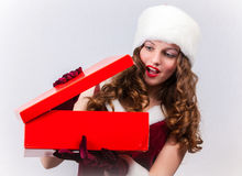 Christmas Santa hat  woman hold christmas gift Stock Photography
