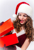Christmas Santa hat  woman hold christmas gift Stock Images