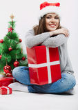 Christmas Santa hat  woman portrait hold christmas gift. Stock Photo