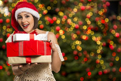 Christmas Santa hat  woman portrait hold christmas gift. Stock Photos