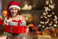 Christmas Santa hat  woman portrait hold christmas gift. Royalty Free Stock Photography