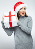 Christmas Santa hat  woman portrait hold christmas gift. Stock Images
