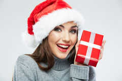 Christmas Santa hat  woman portrait hold christmas gift. Stock Image
