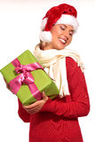 Christmas Santa hat  woman portrait hold christmas gift Royalty Free Stock Image