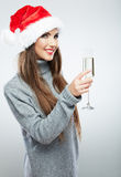Christmas Santa hat  woman portrait hold wine glass. Royalty Free Stock Photos