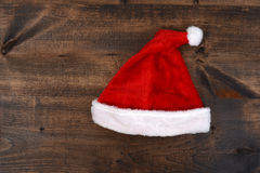 Christmas santa hat on wood Royalty Free Stock Photo