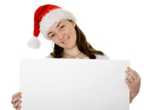 Christmas santa holding a notice board Stock Photos