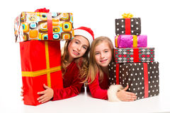Christmas Santa kid girls with many gifts stacked. Isolated on white royalty free stock photos