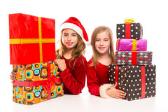 Christmas Santa kid girls with many gifts stacked. Isolated on white stock images