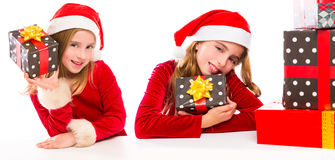 Christmas Santa kid sister girls happy excited with ribbon gifts. Isolated on white background royalty free stock image