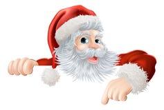 Christmas Santa pointing down at sign Stock Photo