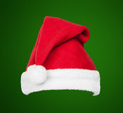 Christmas Santa red hat isolated on green Stock Photo