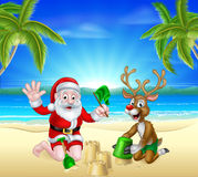 Christmas Santa and Reindeer on Summer Beach Royalty Free Stock Photography