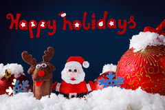 Christmas Santa and reindeer toys on snow with festive New Year balls Stock Images