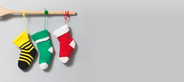 Christmas Santa socks on gray background. Colorful christmas stockings decoration element. yellow green red sock. Copy. Space stock photos
