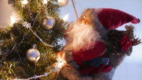 Christmas Santa on a tree. Christmas Santa decoration on a tree Stock Photo