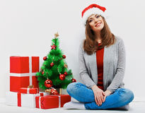 Christmas santa woman with christmas gift. Isolated smiling wom Stock Image