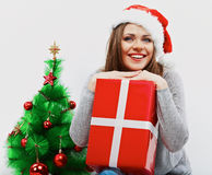 Christmas santa woman with christmas gift. Isolated smiling wom Royalty Free Stock Image