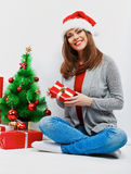 Christmas santa woman with christmas gift. Isolated smiling wom Royalty Free Stock Photography