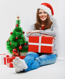 Christmas santa woman with christmas gift. Isolated smiling wom Stock Photos