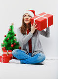 Christmas santa woman with christmas gift. Isolated smiling wom Royalty Free Stock Images