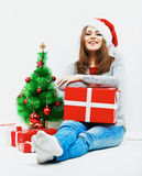 Christmas santa woman with christmas gift. Isolated smiling wom Royalty Free Stock Photo