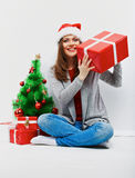 Christmas santa woman with christmas gift.  smiling wom Royalty Free Stock Images