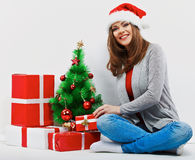 Christmas santa woman with christmas gift.  smiling wom Royalty Free Stock Photo