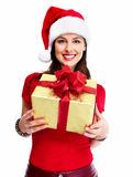 Christmas santa woman with gift. Stock Photo
