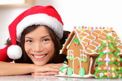 Christmas santa woman and gingerbread house stock photography