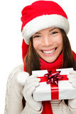 Christmas santa woman holding gift royalty free stock images