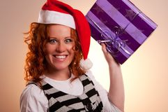 Christmas santa woman holding gift Royalty Free Stock Photography