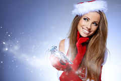Christmas Santa  woman portrait hold christmas gift. Royalty Free Stock Image