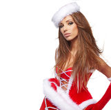 Christmas Santa  woman portrait hold christmas gift. Royalty Free Stock Photo