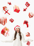 Christmas Santa woman - raining gifts stock images