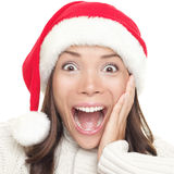 Christmas santa woman surprised. Beautiful face of happy asian woman in santa hat Stock Photos