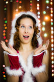Christmas santa woman surprised Stock Images