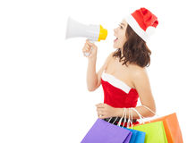 Christmas santa woman using a megaphone with gift bags Stock Photography