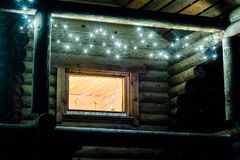 Christmas Sauna. The outdoor sauna building is decorated with tiny lamp lights during the Christmas time royalty free stock images
