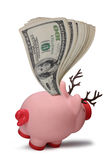 Christmas savings piggy bank. Wad of one hundred dollar bank notes in pink reindeer piggy bank, isolated on white background Stock Photography