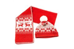 The christmas scarf and the bonnet on the white background. The objects are isolated on white and a clipping path is provided for easy extraction Royalty Free Stock Image