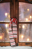 Christmas Scarf Hanging at Window Pane Royalty Free Stock Photography