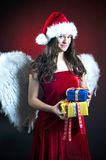 Christmas scene with angel girl Stock Photos