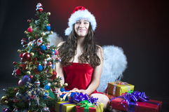 Christmas scene with angel girl Royalty Free Stock Photo