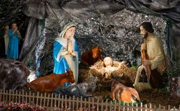 Christmas scene with baby Jesus and his family. Christmas scene with baby Jesus indoor Stock Images
