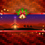 Christmas scene on brick wall background with bells and bow Stock Images