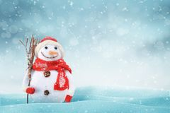 Christmas scene with a cute snowman. Free space for text on right side